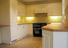 A fully fitted kitchen with a full range of appliances